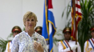U.S. endurance swimmer Diana Nyad wears her Order of Sporting Merit medal as she stands in front of the Cuban and U.S. flags during a ceremony in Havana, Cuba, Saturday, Aug. 30, 2014. Cuba honored Nyad for being the first swimmer to make the crossing between Cuba and Florida without flippers or a shark cage for protection. Nyad made four previous attempts; first in 1978, and three times in 2011 and 2012. (AP Photo/Ramon Espinosa) The Associated Press