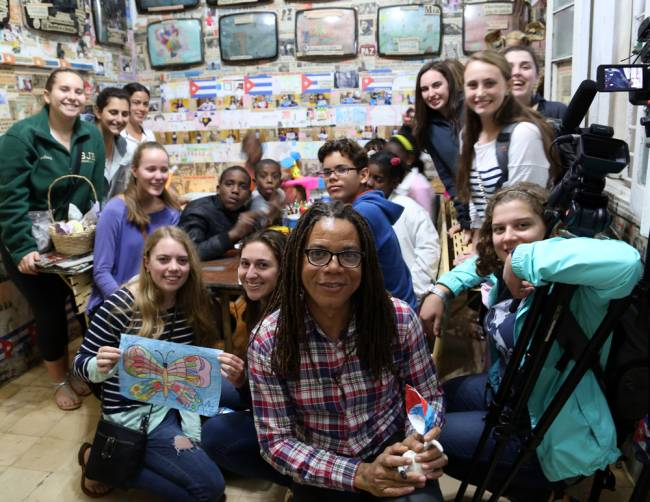 PHOTO COURTESY OF STEPHANIE BRODEUR, Immaculate Heart Academy documentary students join local children in the Havana home of artist Lazaro Salsita.