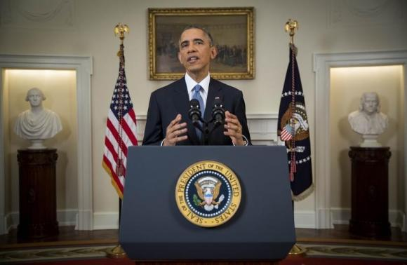 U.S. President Barack Obama announces a shift in policy toward Cuba while delivering an address to the nation from the Cabinet Room of the White House in Washington, December 17, 2014.  Credit: Reuters/Doug Mills/Pool