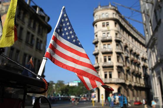 A U.S. flag flutters from a bicycle taxi in a Havana, Cuba, street on 15 April 2015. —European Pressphoto Agency