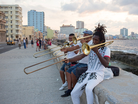 Musicians perform for passersby on the old stone seawall of Havana's Malecón. (Photograph by Erika Skogg)