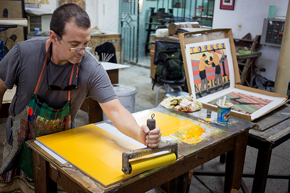 An artist at work in Havana's Taller Experimental de Grafica workshop. (Photograph by Erika Skogg)