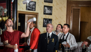 Argentine bartender Christian Delpech (left), who lives and works in Las Vegas, plays with bottles of rum at the Floridita bar in Havana, on July 24, 2015. AFP/Adalberto Roque