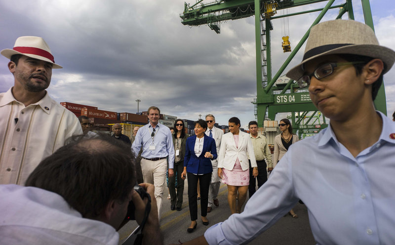 U.S. Commerce Secretary Penny Pritzker (in blue jacket), visits the container port at the Special Enterprise Zone in Mariel, Cuba, on Oct. 6. Cuba is creating the zone to encourage trade and foreign investment. Some foreign companies are eager to move in, though the Pritzker said Cuba's commitment to free trade was not year clear. Ramon Espinosa/AP