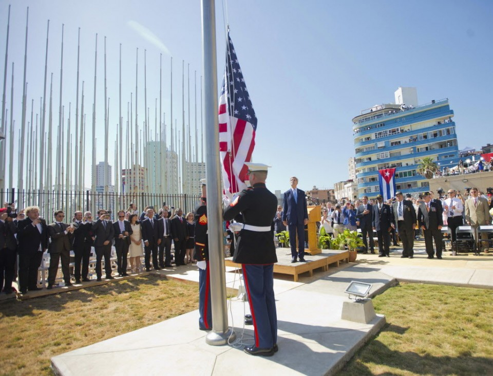 1 / 9 In this Friday, Aug. 14, 2015 photo, Secretary of State John Kerry, and other dignitaries, watch as U.S. Marines raise the U.S. flag over the newly reopened embassy in Havana, Cuba. Kerry attended the reopening of the U.S. Embassy after 54 years of broken