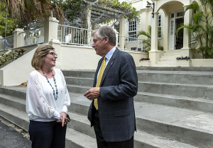 Caterpillar Inc. Chairman and CEO Doug Oberhelman speaks with an official from the Cuban Ministry of Culture in front of Finca Vigia, the Cuban home and museum of Ernest Hemingway, during a trip to the island nation last week.